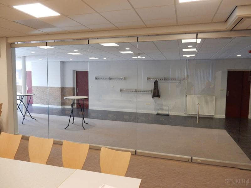 A slim glass partition in an office