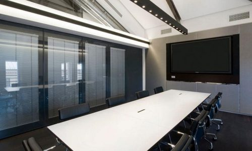 Light retention with a sound dampening glass wall
