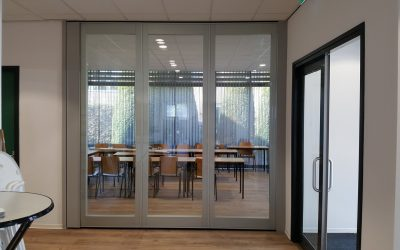 Glass wall TransSpace combines sound insulating panels with light retention