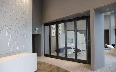 Sound insulating glass wall for maximum light retention